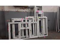 TEN ASSORTED WHITE UPVC WINDOW FRAMES (no glass only frames)