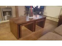 Brown solid oak coffee table an side table...coffe table has 2 solid oak underneath nest tables