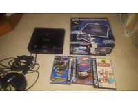 sega saturn in box with games