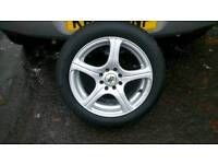 """Multi fit 15"""" 4 stud alloys with matching mint tyres."""