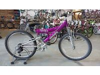 OLDER GIRLS RALEIGH ATTITUDE BIKE 24 INCH WHEELS FULL SUSPENSION 18 SPEED PURPLE/SILVER GOOD COND