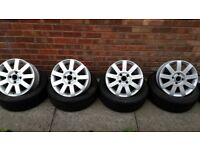 """4 ford 15"""" alloy wheels with 5 tyres"""