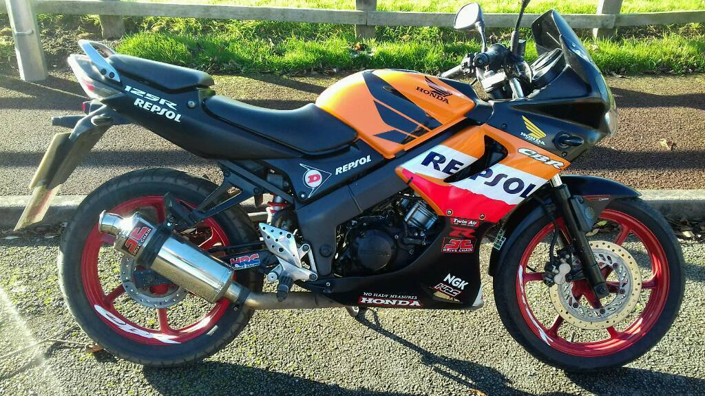 Cbr 125r repsol orange yellow and black