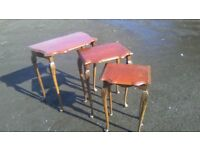 Very elegant vintage nest of three tables,
