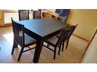 Black extensible dinner table