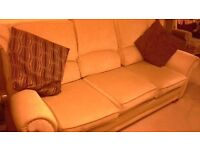 Beige/light gold coloured 3 seater sofa