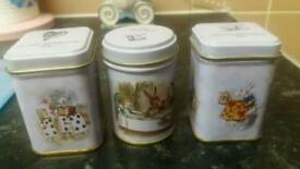 Small set of 3 Alice in wonderland tins.3 inches high