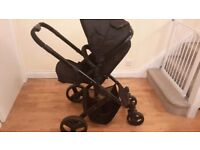 Travel system with carrycot and pram seat