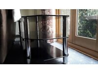 Black glass tv stand with chrome legs for sale