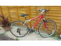 Carrera crossfire ladies bike , 21 speed , red and silver only used a few times .