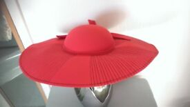 Lady's red coloured hat