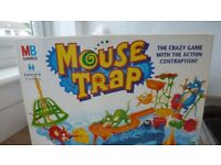 Mouse trap and monopoly board games