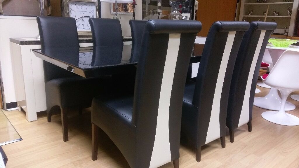 Nero dining table and 6 chairsin Nottingham, NottinghamshireGumtree - Nero black speckle dining table and 6 black and cream leather chairs Beautiful set Table top has a few scuffs hence price chairs new ex display 180x100cm Viewing welcome can deliver for a fee