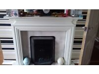 Wood fire surround with marble back and base