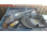 """Bosch 9"""" angle grinder 110V with lots of discs."""