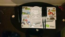 Nintendo Wii with 2 controllers, 3 games and 2 steering wheels