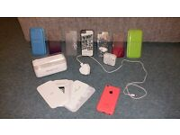 UNLOCKED Apple iPhone 5C and lots of accessories.