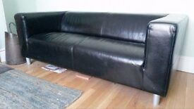 A pair of black leather sofas (£120)