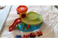 ELC toy whizz around garage with ramps, lift, mechanic station, car wash and mechanic lift
