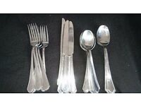 Six person cutlery set and servers