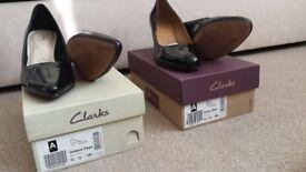 2 pr Clarks shoes, 1 faux fur coat, 1 padded coat, 1 jacket