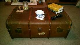 Antique vintage steamer trunk for storage or coffee table