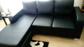 Black faux leather corner sofa £160. 00. O. N. O can be used left or right hand facing