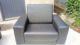Leather arm chair and foot stool
