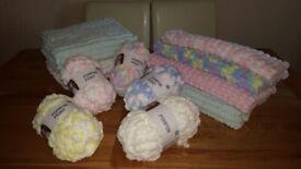 Knitted baby pram blanket in pom pom wool. Various colours. Length 70cm x 53cm approx.