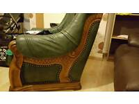 Very heavy green leather chairs
