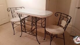 Cast iron and wicker table and chairs