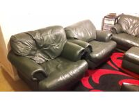 Leather sofa, pouf and armchairs for sale.