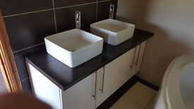 Double sinks taps and cabinet