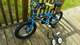 Toddlers bicycle with add on stabilisers