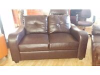 Brown leather button back 2 seater sofa - like new. I can also arrange delivery if required
