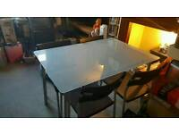 Frosted Glass table and 4 chairs £40 ONO