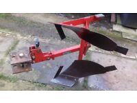 Reversible plough attachment for rotavator
