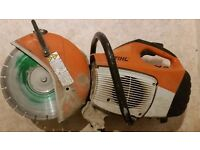 "Stihl saw kit with new 12"" diamond blade and water supression kit."