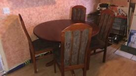 Round extendable dining table and four chairs