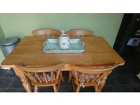 Solid Pine table and four chairs. Farm House country kitchen style up cycle project