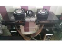 Record and cdjs set up with mixer amp and speakers and dnb records