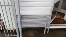 Single metal bed frame with wooden slats. Can take single mattress of 200x90cm