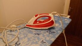Iron and Ironing board. Both in excellent condition. The board is covered as in the picture.