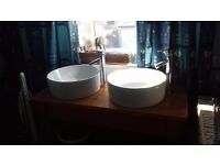 Double Tabletop Bathroom Sink for sale. Pine table with circular ceramic sinks and chrome taps.