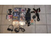 Slimline PS2 with games, 2 controllers, 3 memorycards, replay racing wheel and USB