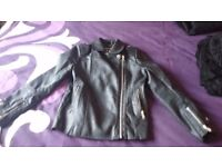 Girls River Island leather look black jacket age 9. Excellent condition