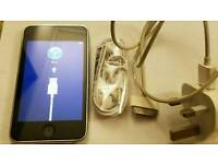 Apple iPod Touch 2nd Generation 8GB with the charger, cable and brand new headphone.