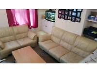 Cream leather sofa 2 and 3 seaters and footstool