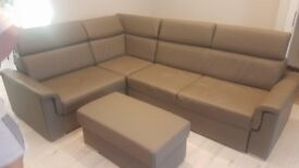 Corner sofa bed with storage and poufe