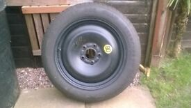 Ford focus space saver spare wheel. 5 stud in new condition. never used.